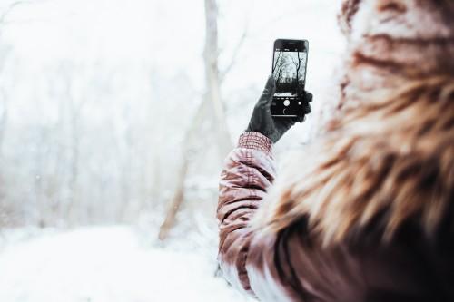 girl-shooting-with-her-iphone-6-in-winter-picjumbo-coma93e0c215239f047.jpg