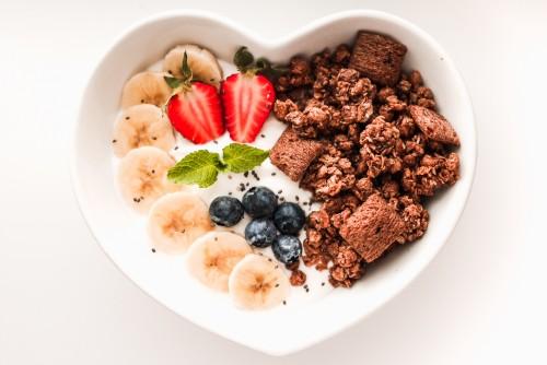 fresh-healthy-breakfast-in-heart-shaped-bowl8fa8832bc300b466.jpg