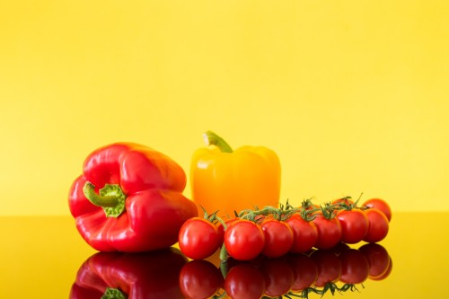 red-and-yellow-paprikas-with-tomatoes-still-life_free_stock_photos_picjumbo_DSC0835857e8c0d6ba3738f9.jpg