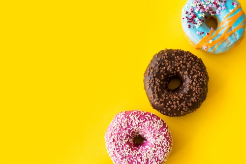 yummy-donuts-on-yellow-background5a267a6579d66c9b.jpg