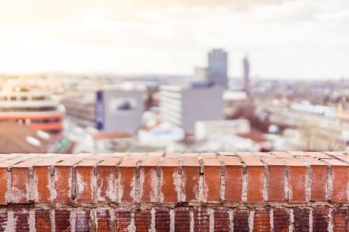 empty-brick-wall-with-blurred-city-view-background_free_stock_photos_picjumbo_DSC033127278229b5066650f.jpg